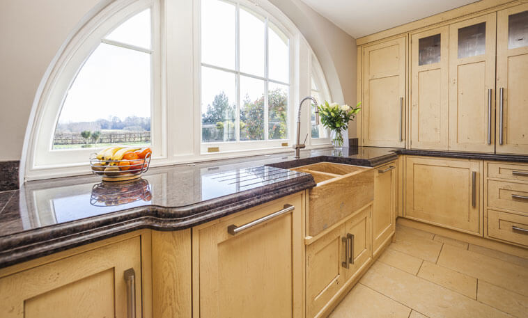 Limestone sink in traditional kitchen