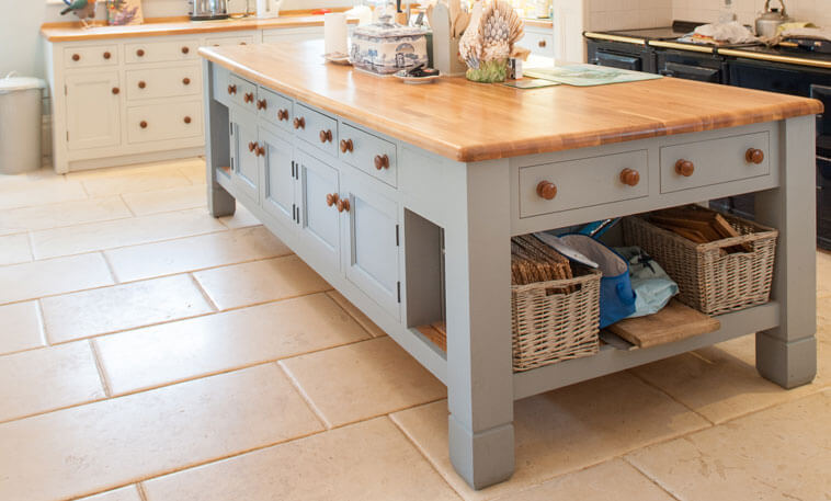 farmhouse style kitchen with limestone floor
