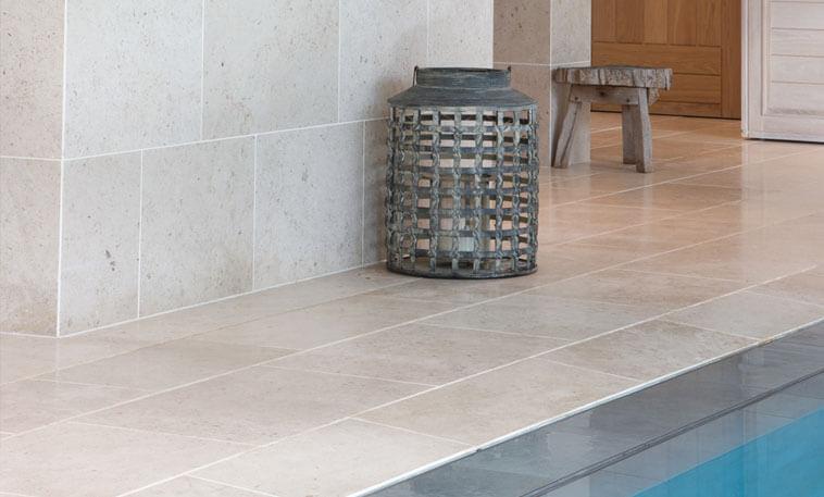 contemporary limestone tiles pool area
