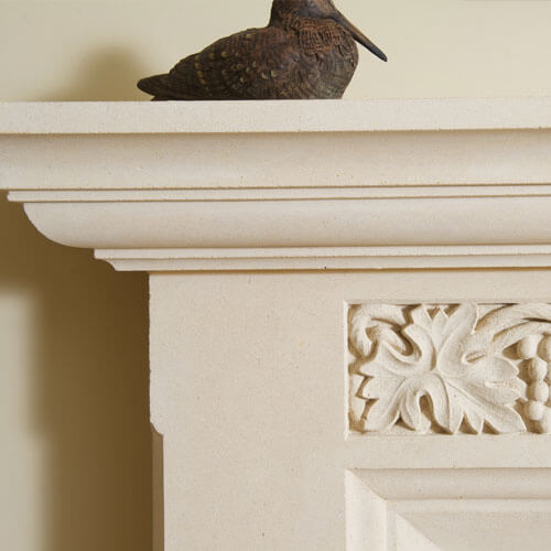 bespoke stone fireplace intricate carving