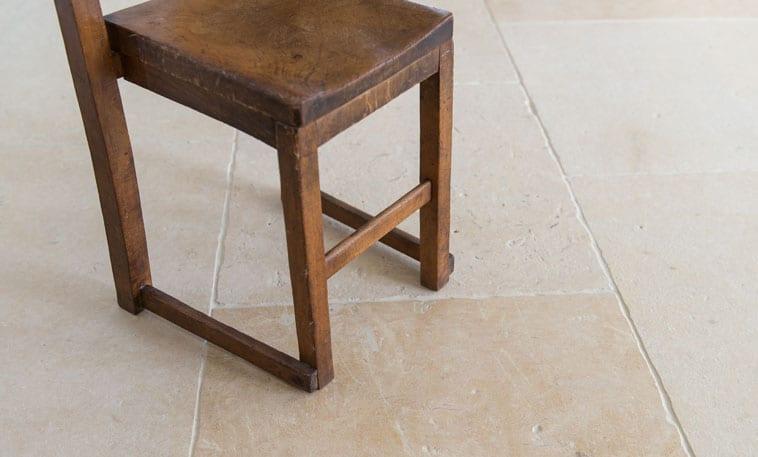 Audbourn Distressed Stone Flooring chair